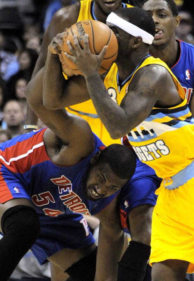 Photo -   Denver Nuggets guard Ty Lawson (3) scoops up a loose ball against Detroit Pistons forward Jason Maxiell (54) during the first quarter of an NBA basketball game, Tuesday, Nov. 6, 2012, in Denver. (AP Photo/Jack Dempsey)