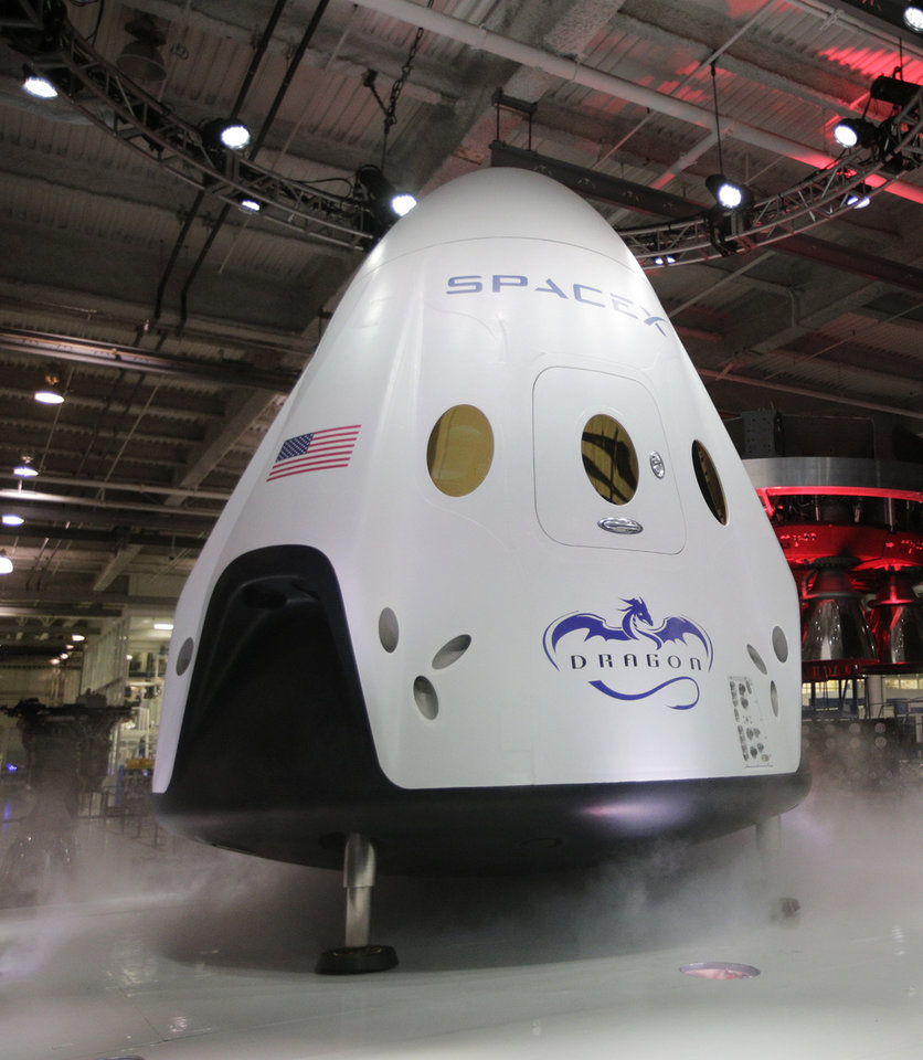 Photo -  The SpaceX Dragon V2 spaceship is unveiled Thursday at its headquarters  in Hawthorne, Calif.  AP Photos   Jae C. Hong -  AP