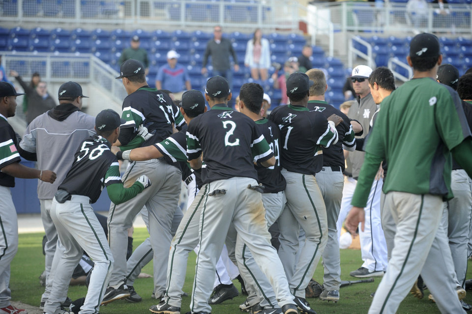 Photo - A brawl breaks out at on the field at Maritime Park Stadium Wednesday during a game between Norman North and Arlington as part of the 2013 Aggie Classic. PHOTO BY PENSACOLA NEWS JOURNAL  Ben Twingley/btwingley@pnj.com - Ben Twingley/btwingley@pnj.com