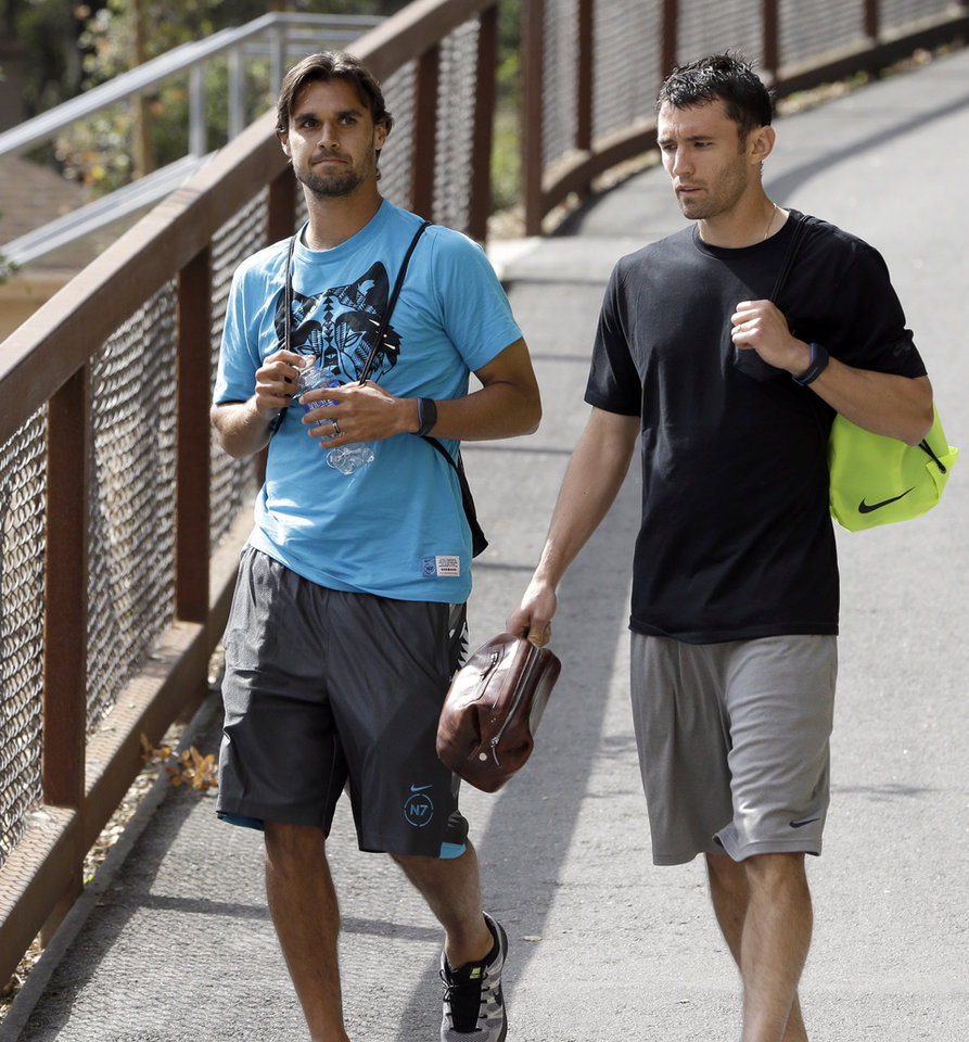 Photo - United States' Chris Wondolowski, left, and Michael Parkhurst arrive at U.S. practice in preparation for the World Cup soccer tournament, Thursday, May 22, 2014, in Stanford, Calif. (AP Photo/Ben Margot)
