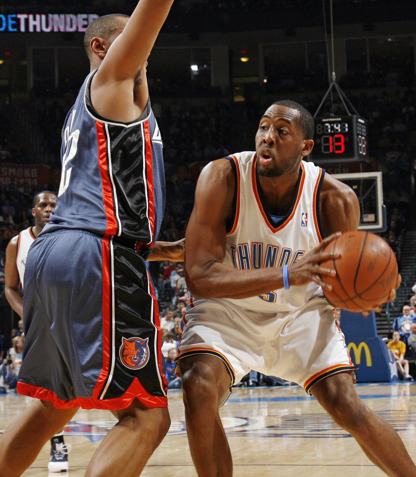 Photo - Oklahoma City's D.J. White (3) tries to get past Charlotte's Boris Diaw (32) in the first half during the NBA basketball game between the Charlotte Bobcats and the Oklahoma City Thunder at the Ford Center in Oklahoma City, Friday, April 10, 2009. Photo by Nate Billings, The Oklahoman ORG XMIT: KOD