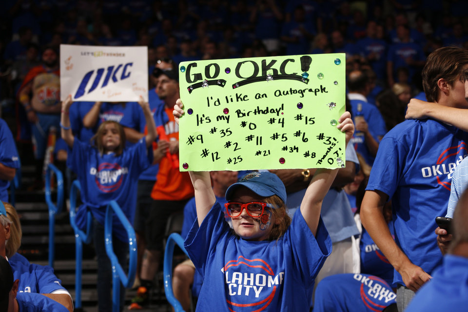 Photo - Fan Dalani Beeler, 10, of Chelsea, Okla., holds a sign for the Thunder before Game 1 of the Western Conference semifinals in the NBA playoffs between the Oklahoma City Thunder and the Los Angeles Clippers at Chesapeake Energy Arena in Oklahoma City, Monday, May 5, 2014. The day of the game was her birthday. Photo by Sarah Phipps, The Oklahoman