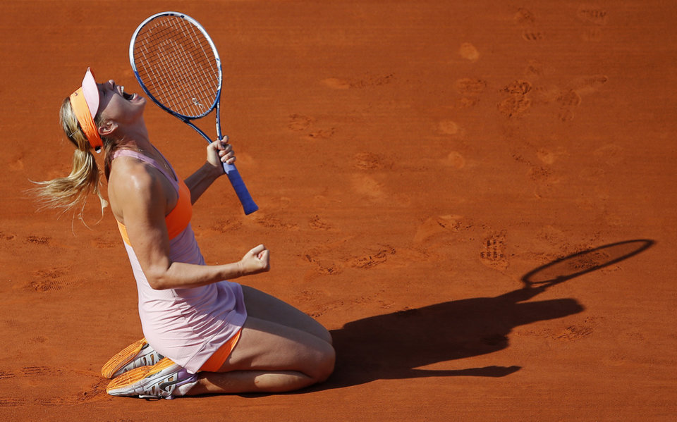Photo - FILE - In this June 7, 2014, file photo, Russia's Maria Sharapova reacts after defeating Romania's Simona Halep during their final match of  the French Open tennis tournament at the Roland Garros stadium, in Paris, France. Can't list this years U.S. Open contenders without naming Sharapova, whose five major championships include the 2006 U.S. Open. (AP Photo/David Vincent, File)