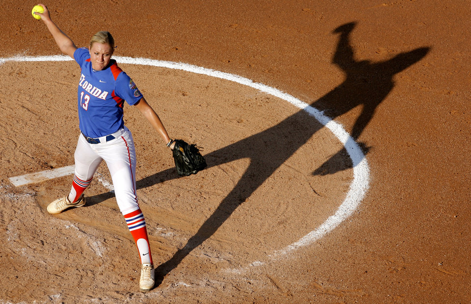 Photo - Florida's Hannah Rogers (13) pitches during the Women's College World Series game between Florida and Alabama at the ASA Hall of Fame Stadium in Oklahoma City, Sunday, June 5, 2011. Photo by Garett Fisbeck, The Oklahoman