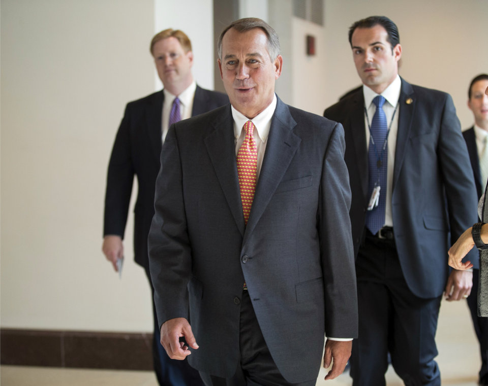 Photo - Speaker of the House John Boehner, R-Ohio, returns to his office after speaking with reporters about the deadline to fund the government and the fight among House Republicans, on Capitol Hill in Washington, Thursday, Sept. 19, 2013. House Republicans vowed Wednesday to pass legislation that would prevent a partial government shutdown and avoid a default while simultaneously canceling out President Barack Obama's health care overhaul, inaugurating a new round of political brinkmanship as critical deadlines approach. (AP Photo/J. Scott Applewhite)