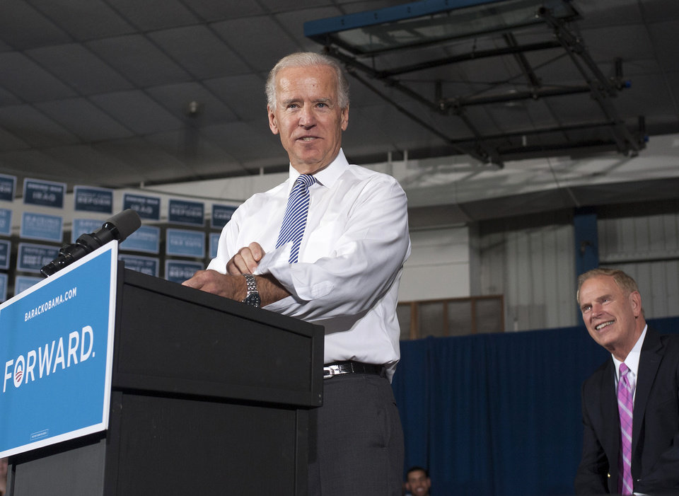 Photo -   Former Ohio Ted Strickland watches at right as Vice President Joe Biden rolls up his sleeves while speaking at a campaign stop at the J. Babe Stearn Community Center in Canton, Ohio, Monday, Oct. 22, 2012. (AP Photo/Phil Long)