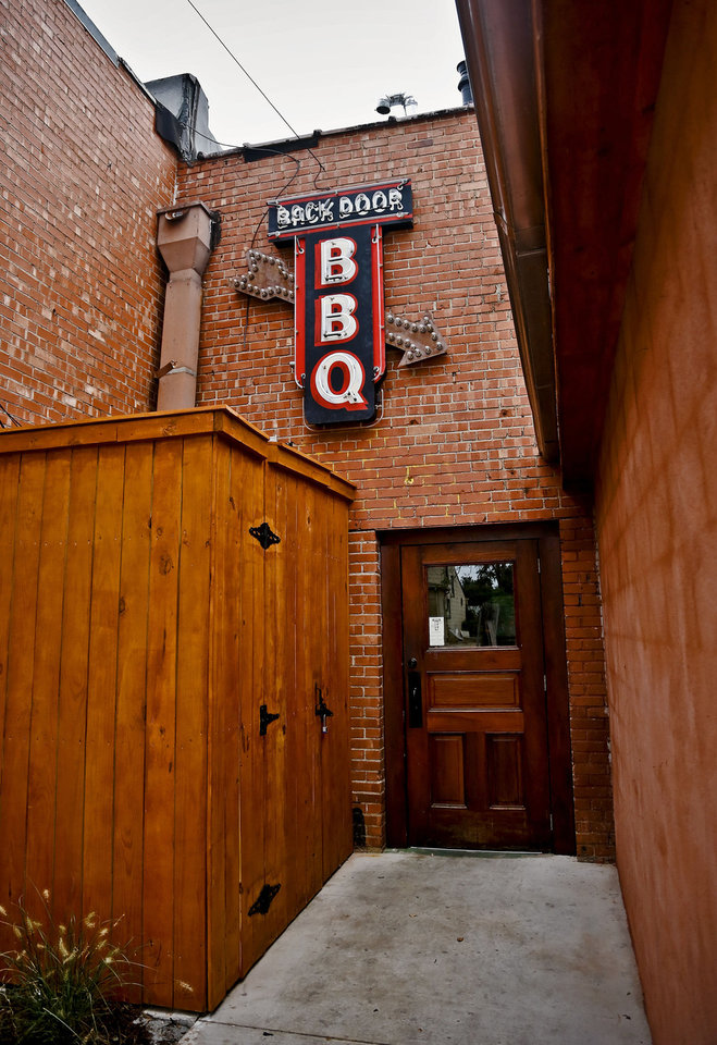 Photo - The main door located in the back of the restaurant at the new Back Door Barbecue at 315 NW 23 in Oklahoma City. Photo by Chris Landsberger, The Oklahoman  CHRIS LANDSBERGER - CHRIS LANDSBERGER