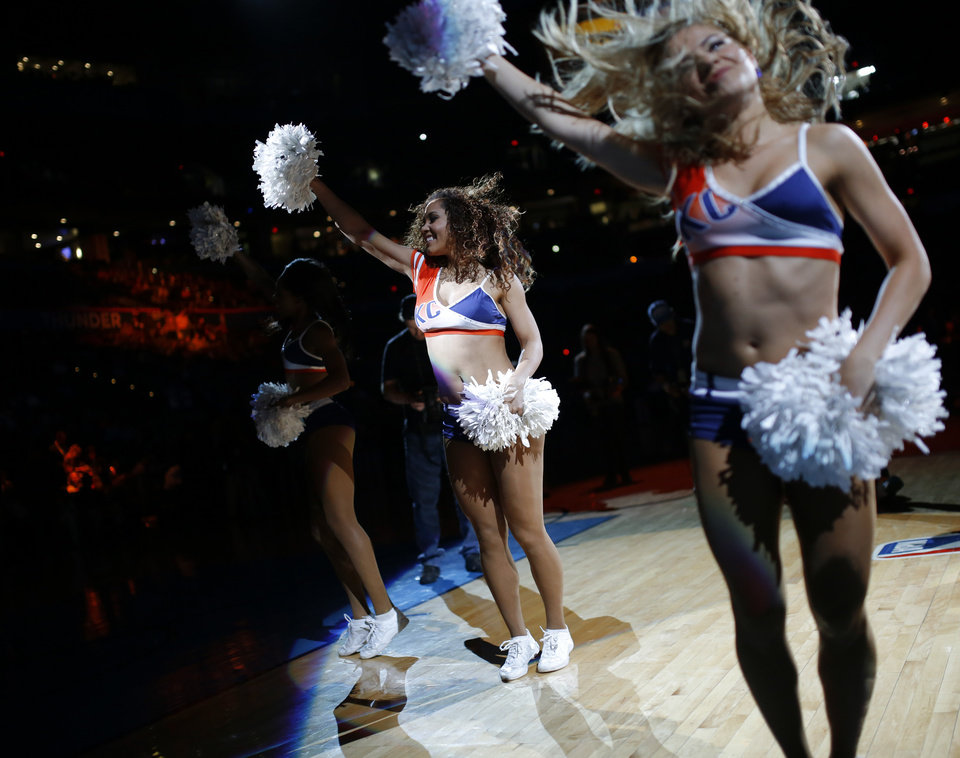 Photo - The Oklahoma City Thunder Girls perform before an NBA basketball game between the Oklahoma City Thunder and the Cleveland Cavaliers at Chesapeake Energy Arena in Oklahoma City, Sunday, Feb. 21, 2016. Oklahoma City lost 115-92.  Photo by Bryan Terry, The Oklahoman
