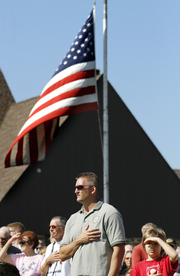 Vernon Conway covers his heart during the massing of the colors at the start of the Memorial Day Ceremony on the grounds of the 45th Infantry Division Museum  on Monday,  May 28,  2012,  Conway is a lieutenant colonel in the Air Forcce and he is currently stationed at Tinker Air Force Base. Photo by Jim Beckel, The Oklahoman