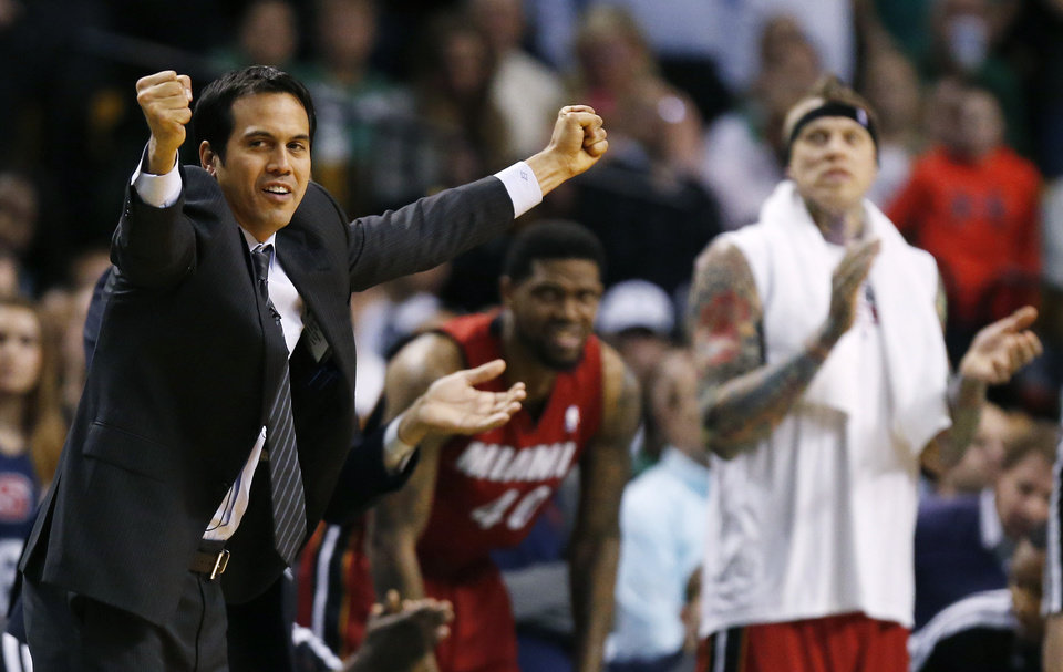 Photo - Miami Heat head coach Erik Spoelstra, left, reacts to play in the fourth quarter of an NBA basketball game against the Boston Celtics in Boston, Monday, March 18, 2013. The Heat won 105-103. (AP Photo/Michael Dwyer)