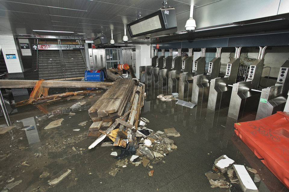 Photo - FILE - In this Oct. 30 2012 file photo provided by the Metropolitan Transportation Authority, the South Ferry subway station in New York City is filled with seawater and debris from Superstorm Sandy. A presidential task force charged with developing a strategy for rebuilding coastal areas damaged by Sandy will issue a report on Monday, Aug. 19, 2013, recommending 69 measures that might help insure that coastal areas aren't as vulnerable to future storms in an age of rising sea levels. (AP Photo/ Metropolitan Transportation Authority, Patrick Cashin, File)