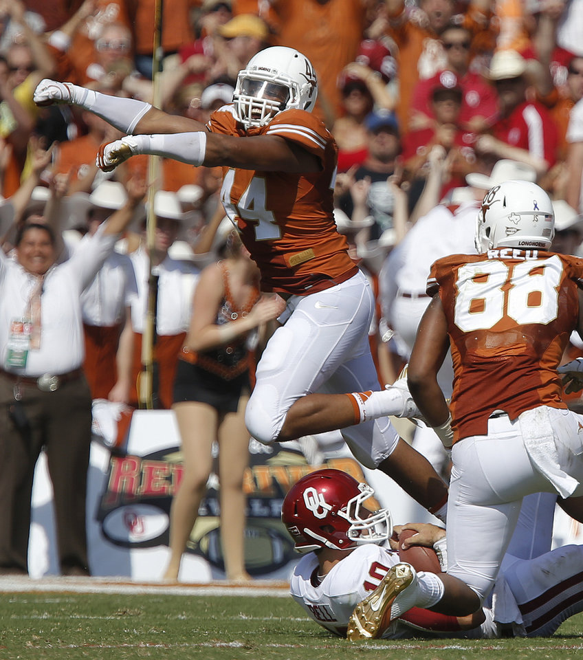 UT's Jackson Jeffcoat (44) celebrates after bringing down OU's Blake Bell (10) during the Red River Rivalry college football game between the University of Oklahoma Sooners and the University of Texas Longhorns at the Cotton Bowl Stadium in Dallas, Saturday, Oct. 12, 2013. Texas won 36-20. Photo by Bryan Terry, The Oklahoman