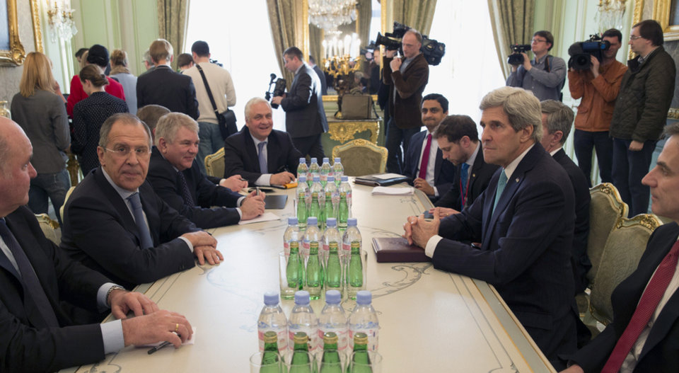 Photo - Secretary of State John Kerry and Russian Foreign Minister Sergei Lavrov meet at the Russian Ambassador's Residence in Paris, Wednesday, March 5, 2014. Russia rebuffed Western demands to withdraw forces in Ukraine's Crimea region to their bases on Wednesday amid a day of high-stakes diplomacy in Paris aimed at easing tensions over Ukraine and averting the risk of war.  (AP Photo/Kevin Lamarque, Pool)