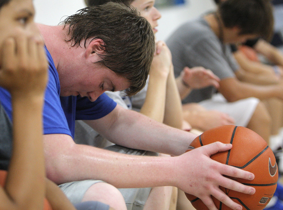 Photo - Carson Foreman, 15 of Bridgecreek, wipes sweat from his face during the Blake Griffin basketball camp at the Santa Fe Family Life Center in Oklahoma City Thursday, Aug. 4, 2011.  Photo by Garett Fisbeck, The Oklahoman