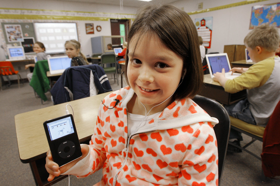 Photo - Fourth-grader McKenna Covy with school iPod. Howe Public Schools is using cutting edge technology such as iPods and computers to create podcasts, virtual field trips and help students catch up on homework, Tuesday, February 12, 2008. BY DAVID MCDANIEL, THE OKLAHOMAN    ORG XMIT: KOD