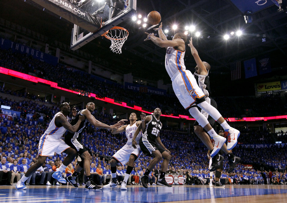 Photo - NBA BASKETBALL: Oklahoma City's Russell Westbrook (0) shoots a layup during Game 3 of the Western Conference Finals between the Oklahoma City Thunder and the San Antonio Spurs in the NBA playoffs at the Chesapeake Energy Arena in Oklahoma City, Thursday, May 31, 2012.  Photo by Sarah Phipps, The Oklahoman