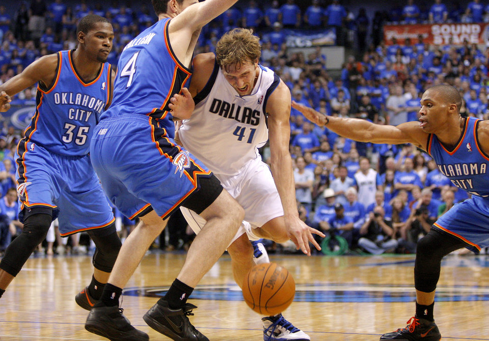 Dallas' Dirk Nowitzki (41) tries to get between Oklahoma City's Kevin Durant (35), Nick Collison (4), and Russell Westbrook (0) during Game 4 of the first round in the NBA playoffs between the Oklahoma City Thunder and the Dallas Mavericks at American Airlines Center in Dallas, Saturday, May 5, 2012. Oklahoma City won 103-97. Photo by Bryan Terry, The Oklahoman