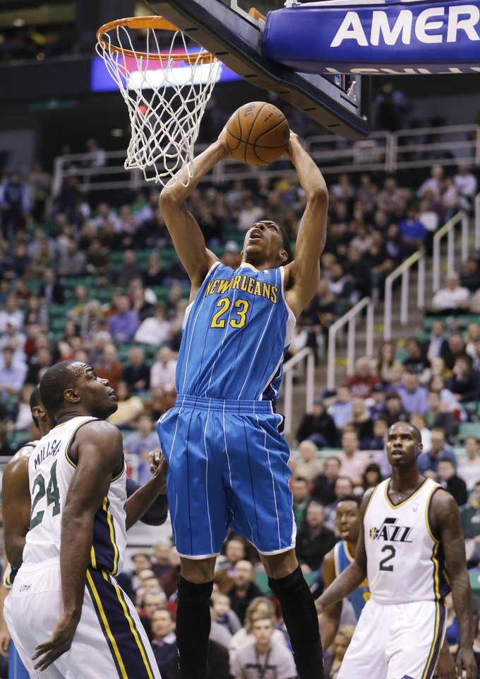 New Orleans Hornets' Anthony Davis (23) goes to the basket as Utah Jazz's Paul Millsap (24) and Marvin Williams (2) watch in the first quarter during an NBA basketball game Wednesday, Jan. 30, 2013, in Salt Lake City. (AP Photo/Rick Bowmer)