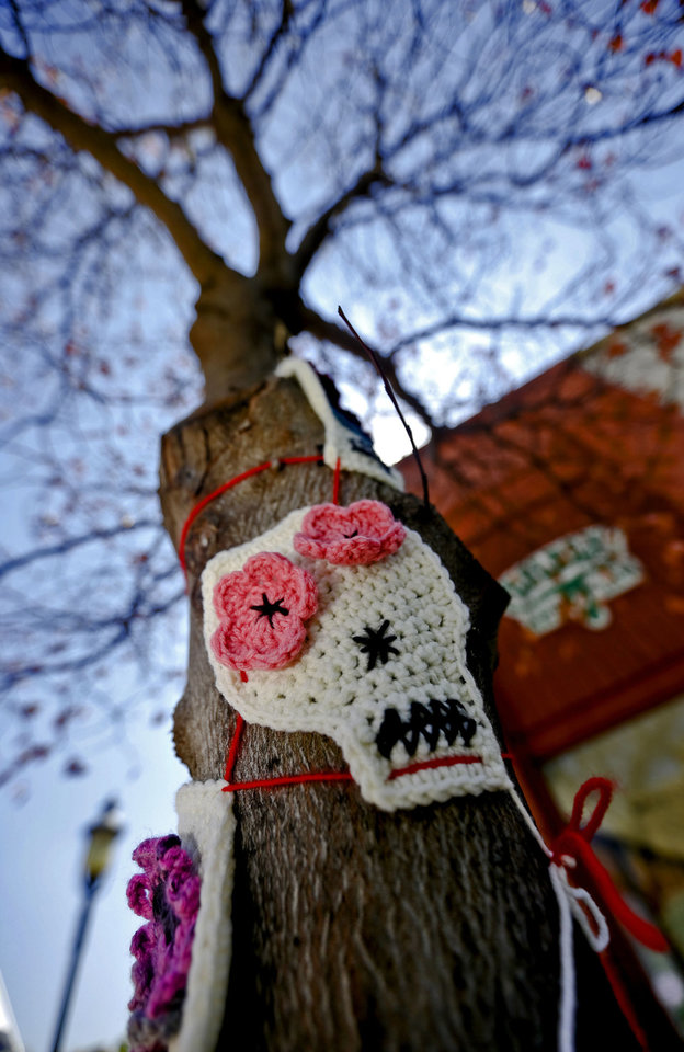 Photo - Knitted and crocheted art is displayed in the Enid town square as part of the Yarnover Enid community art event. Photo by Chris Landsberger, The Oklahoman  CHRIS LANDSBERGER - CHRIS LANDSBERGER