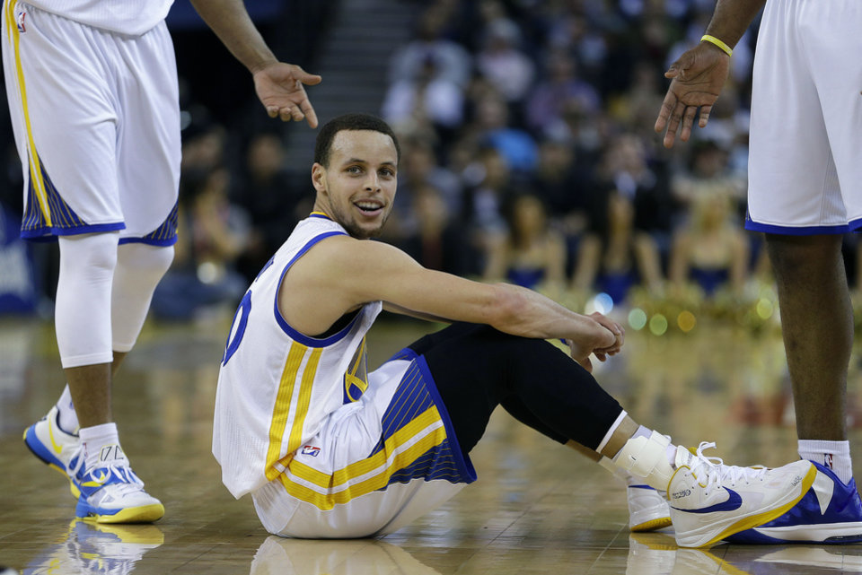 Golden State Warriors' Stephen Curry sits on the floor after being called for a foul against the Sacramento Kings during the first half of an NBA basketball game Wednesday, March 27, 2013, in Oakland, Calif. (AP Photo/Ben Margot)