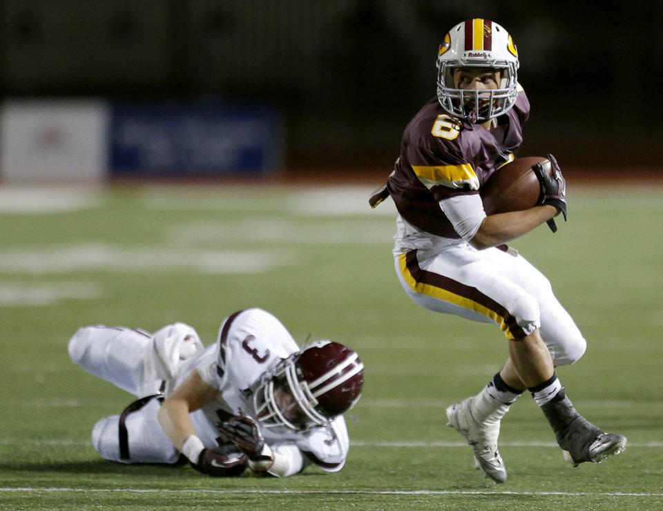 Photo - Clinton's Devon Mitchell gets by Ada's Easton Pingleton during the high school playoff game between Ada and Clinton at Putnam City High School in Oklahoma City, Friday, Nov. 23, 2012. Photo by Sarah Phipps, The Oklahoman