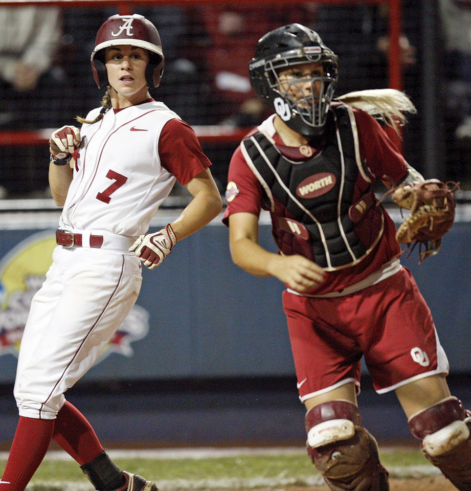 Alabama's Jennifer Fenton (7) scores past Oklahoma catcher Jessica Shults (18) in the fifth innin during Game 3 of the Women's College World Series softball championship between OU and Alabama at ASA Hall of Fame Stadium in Oklahoma City, Wednesday, June 6, 2012.  Photo by Nate Billings, The Oklahoman