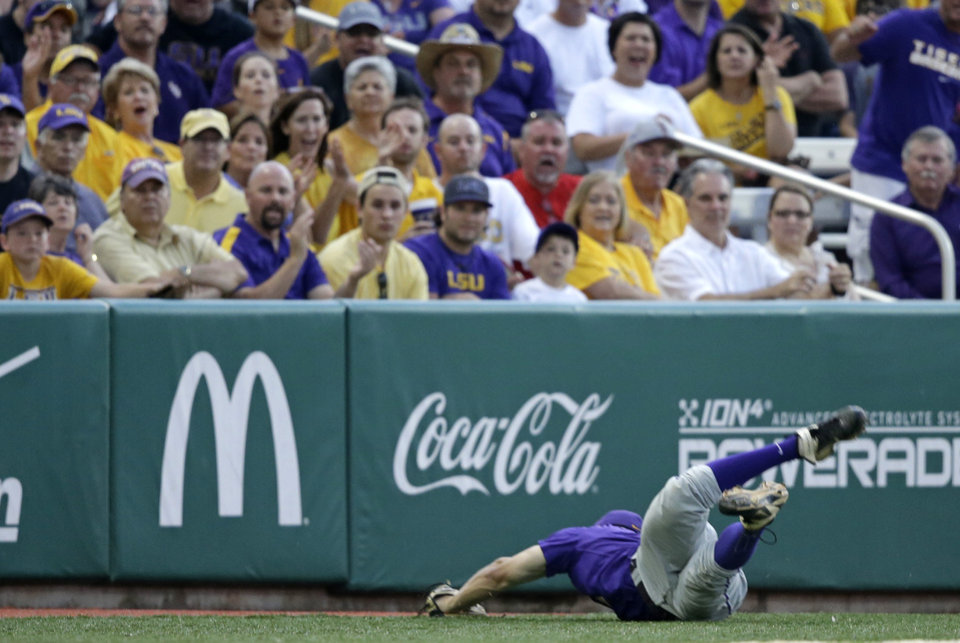 Photo - Fans react as LSU infielder Alex Bregman  grabs a pop-foul off the bat of Houston's Kyle Survance to end the second inning with the bases loaded during an NCAA college baseball regional tournament game in Baton Rouge, La., Saturday, May 31, 2014. (AP Photo/Gerald Herbert)