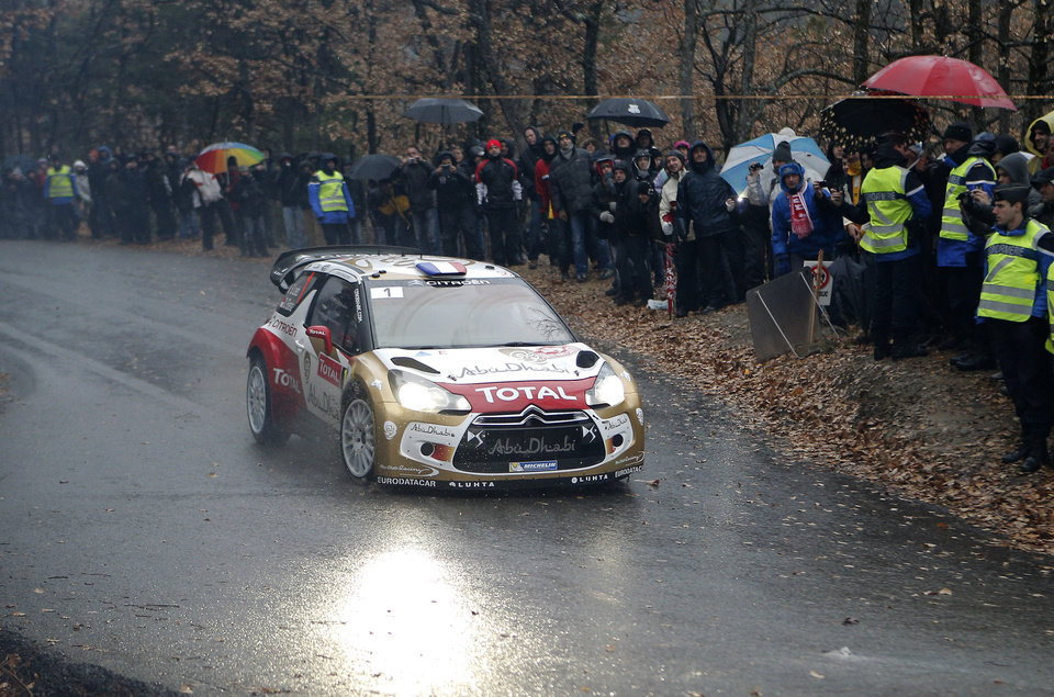 Photo - World champion Sebastien Loeb of France and his co driver Daniel Elena of Monaco steer a Citroen DS3 WRC during the 15th stage of the 81st Rally of Monte Carlo, in Luceram, southeastern France, Saturday, Jan. 19, 2013. (AP Photo/Lionel Cironneau)