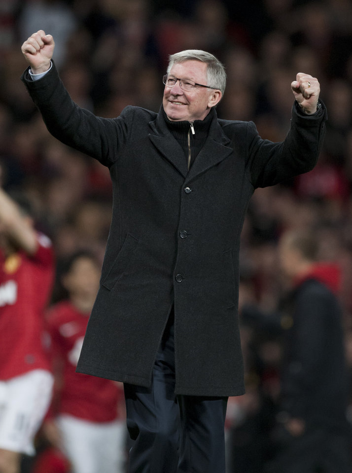 Manchester United's manager Sir Alex Ferguson celebrates as his team wins their 20th English Premier League title after their 3-0 win over Aston Villa in their soccer match at Old Trafford Stadium, Manchester, England, Monday April 22, 2013. (AP Photo/Jon Super)