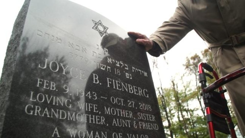 Photo -  Joyce Fienberg's gravestone is the at Tree of Life Memorial Park in Pittsburgh. [Jon Gerberg/The Washington]