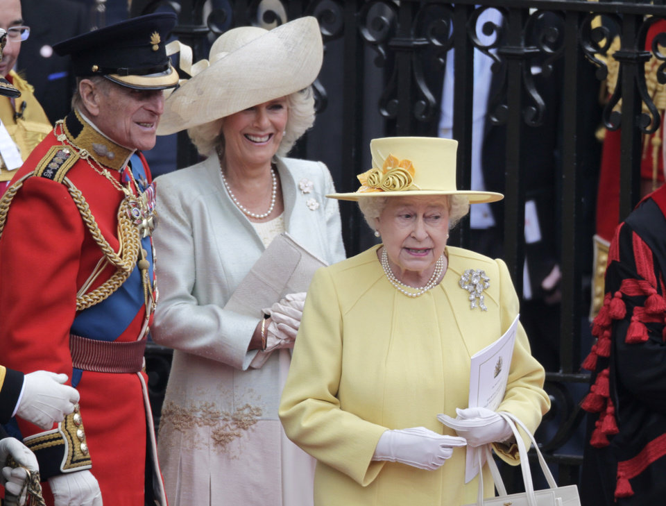 Photo - Britain's Queen Elizabeth II, Camilla, Duchess of Cornwall and Britain's Prince Philip, from right, leave Westminster Abbey at the Royal Wedding in London Friday, April, 29, 2011. (AP Photo/Gero Breloer)  ORG XMIT: RWFO150