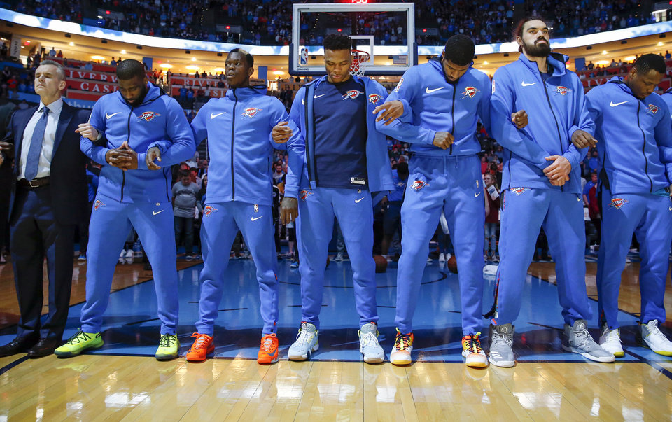 Photo - From left, Oklahoma City head coach Billy Donovan, guard Raymond Felton (2), guard Dennis Schroder (17), guard Russell Westbrook (0), forward Paul George (13), center Steven Adams (12) and guard Deonte Burton (30) stand during the prayer before an NBA basketball game between the Denver Nuggets and the Oklahoma City Thunder at Chesapeake Energy Arena in Oklahoma City, Friday, March 29, 2019. Photo by Nate Billings, The Oklahoman