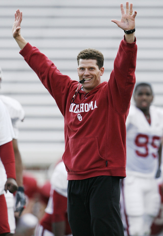 Photo - University of Oklahoma (OU) college football co-defensive coordinator Brent Venables signals touchdown after his defense intercepts a pass during spring practice in Norman, Oklahoma on Wednesday, March 29, 2006.  By Steve Sisney, The Oklahoman.