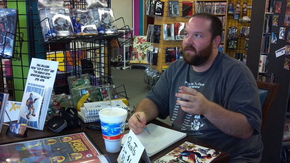 Artist Paul Milligan talks to fans at a local comics shop. Photo by Annette Price, for The Oklahoman. <strong></strong>