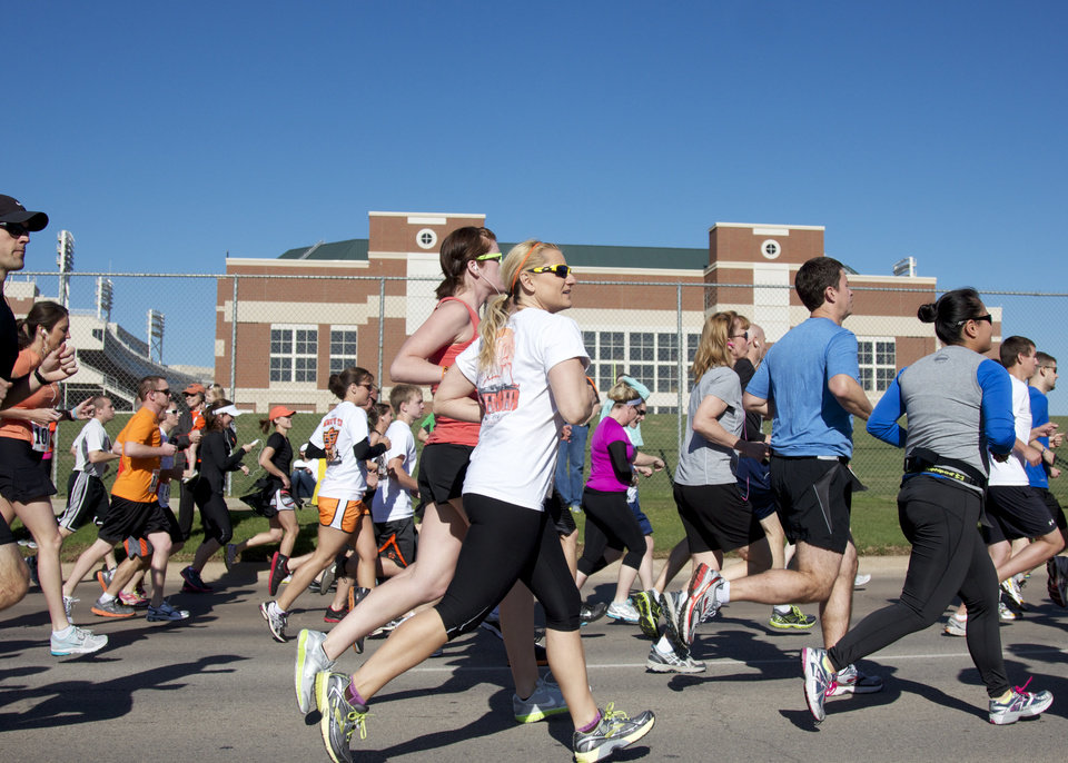 Runners started on Duck street in front of Galliger Iba Arena during the Remember the Ten run held in Stillwater, Okla., on April 21, 2012. Photos by Mitchell Alcala for The Oklahoman  ORG XMIT: KOD