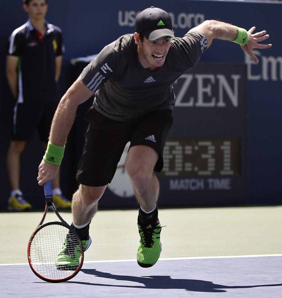 Photo - Andy Murray, of the United Kingdom, chases down a ball against Robin Haase, of the Netherlands, during the opening round of the 2014 U.S. Open tennis tournament, Monday, Aug. 25, 2014, in New York. (AP Photo/Kathy Willens)