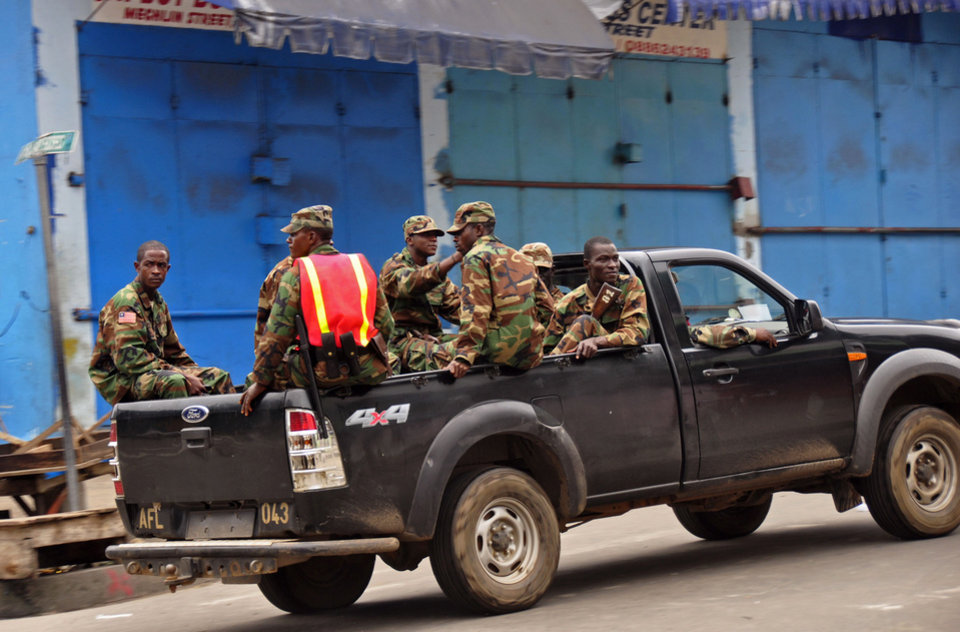 Photo - Liberia security forces patrol areas around the West Point Ebola center as the government clamps down on the movement of people to prevent the spread of the Ebola virus in the city of Monrovia, Liberia, Wednesday, Aug. 20, 2014. Security forces deployed Wednesday to enforce a quarantine around a slum in the Liberian capital, stepping up the government's fight to stop the spread of Ebola and unnerving residents. (AP Photo/Abbas Dulleh)