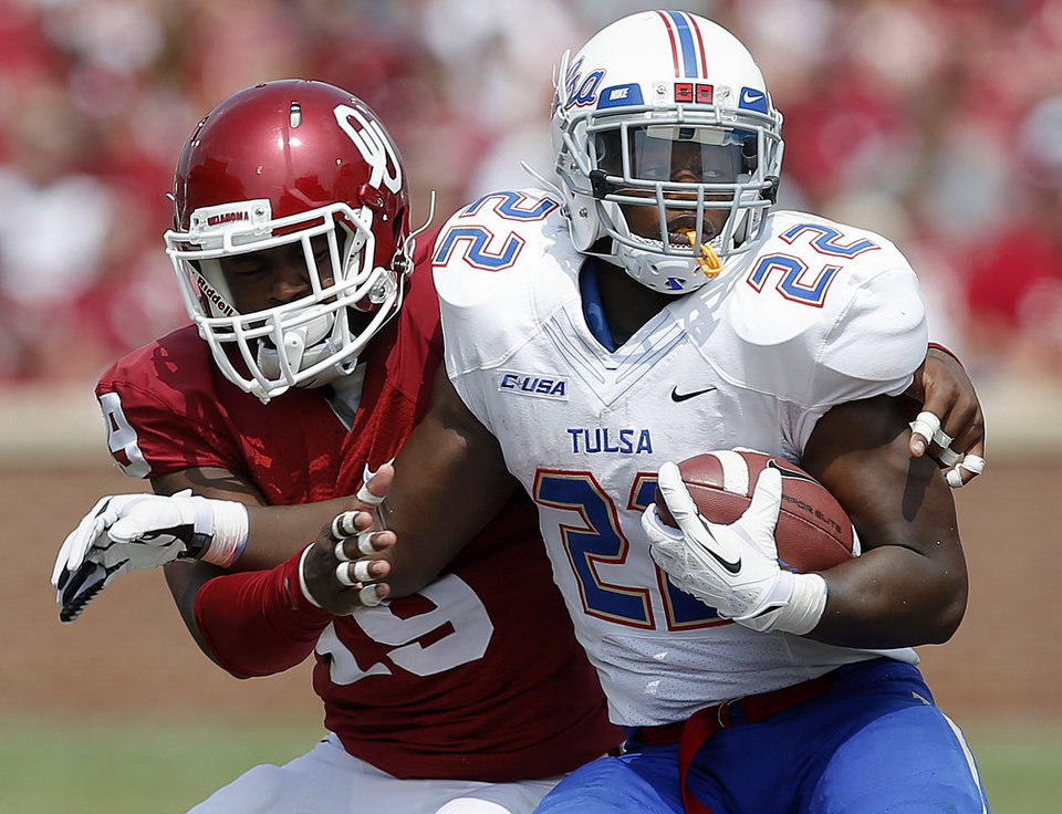 Tulsa's Trey Watts (22) is brought down by Oklahoma's Eric Striker (19) during a college football game between the University of Oklahoma Sooners (OU) and the Tulsa Golden Hurricane at Gaylord Family-Oklahoma Memorial Stadium in Norman, Okla., on Saturday, Sept. 14, 2013. Oklahoma won 51-20. Photo by Bryan Terry, The Oklahoman