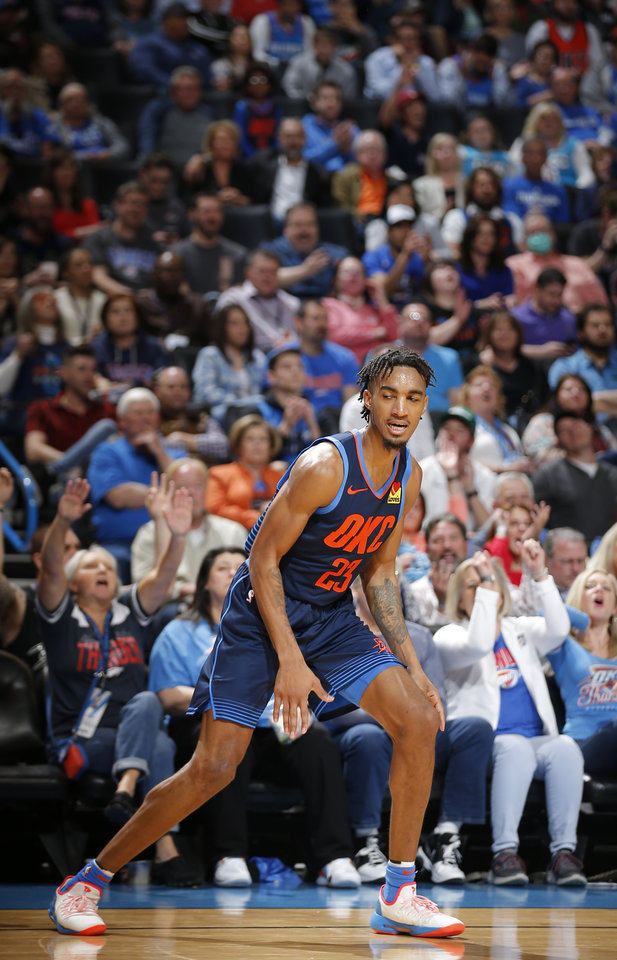 Photo - Oklahoma City's Terrance Ferguson (23) reacts after a 3-point basket during the NBA basketball game between the Oklahoma City Thunder and the Toronto Raptors at the Chesapeake Energy Arena, Wednesday,March 20, 2019. Photo by Sarah Phipps, The Oklahoman