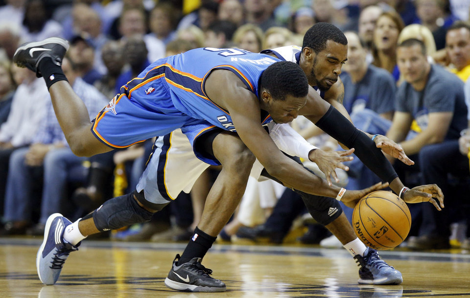 Photo - Oklahoma City's Reggie Jackson (15) and Memphis' Mike Conley (11) chase the ball during Game 4 in the first round of the NBA playoffs between the Oklahoma City Thunder and the Memphis Grizzlies at FedExForum in Memphis, Tenn., Saturday, April 26, 2014. Photo by Bryan Terry, The Oklahoman