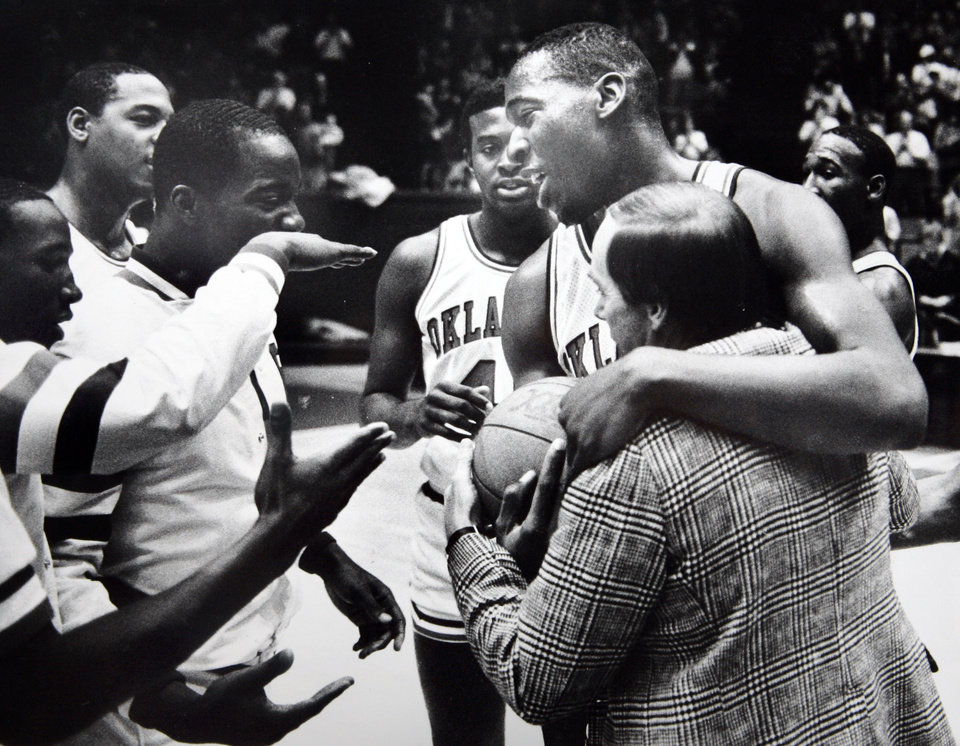 Former OU basketball player Wayman Tisdale. Wayman Tisdale receives accolades from teammates and coach Billy Tubbs after becoming the Big Eight career scoring leader Saturday. The eighth-ranked Sooners open conference play this week, hosting Missouri Wednesday and No. 10 Kansas Saturday. Staff photo by Doug Hoke. Photo taken 1/12/1985, photo published 1/14/1985 in The Daily Oklahoman. ORG XMIT: KOD
