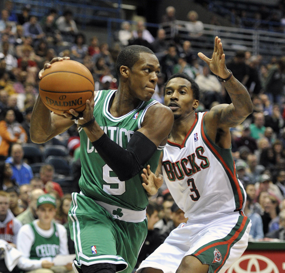 Boston Celtics' Rajon Rondo (9) drives to the basket as Milwaukee Bucks' Brandon Jennings (3) defends during the first half of an NBA basketball game, Saturday, Nov. 10, 2012, in Milwaukee. (AP Photo/Jim Prisching)