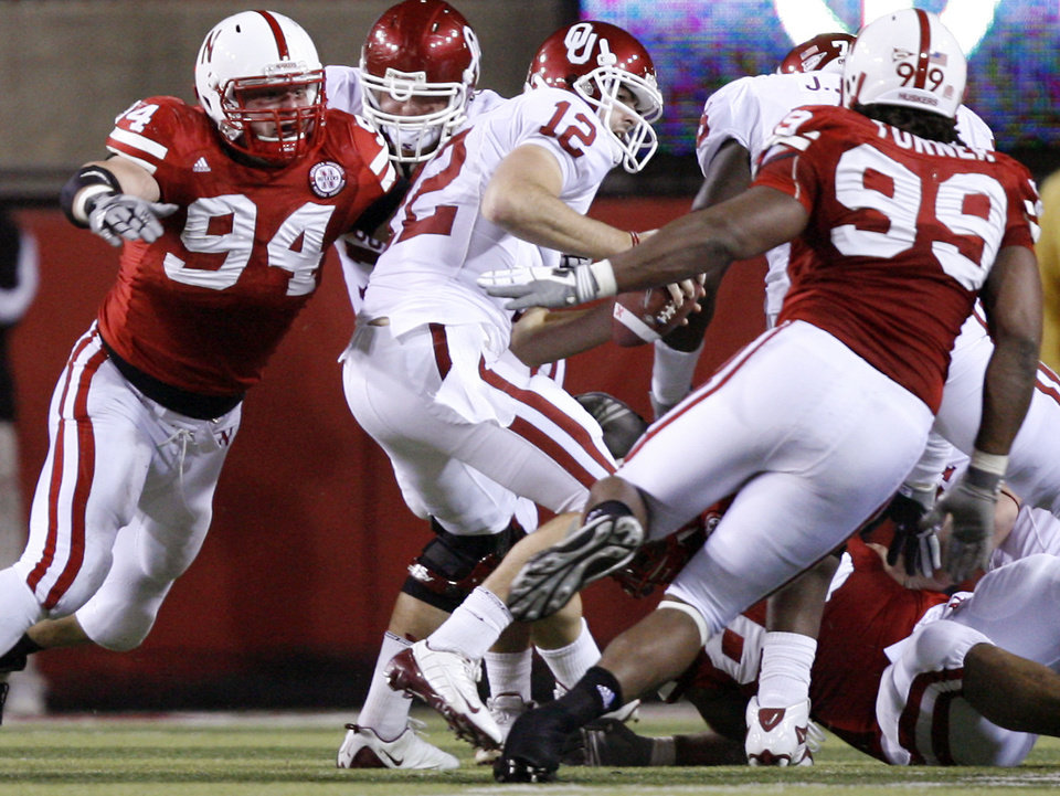 Photo - Nebraska's Jared Crick (94) and Barry Turner (99) sack Oklahoma's Landry Jones (12) during the first half of the college football game between the University of Oklahoma Sooners (OU) and the University of Nebraska Cornhuskers (NU) on Saturday, Nov. 7, 2009, in Lincoln, Neb.