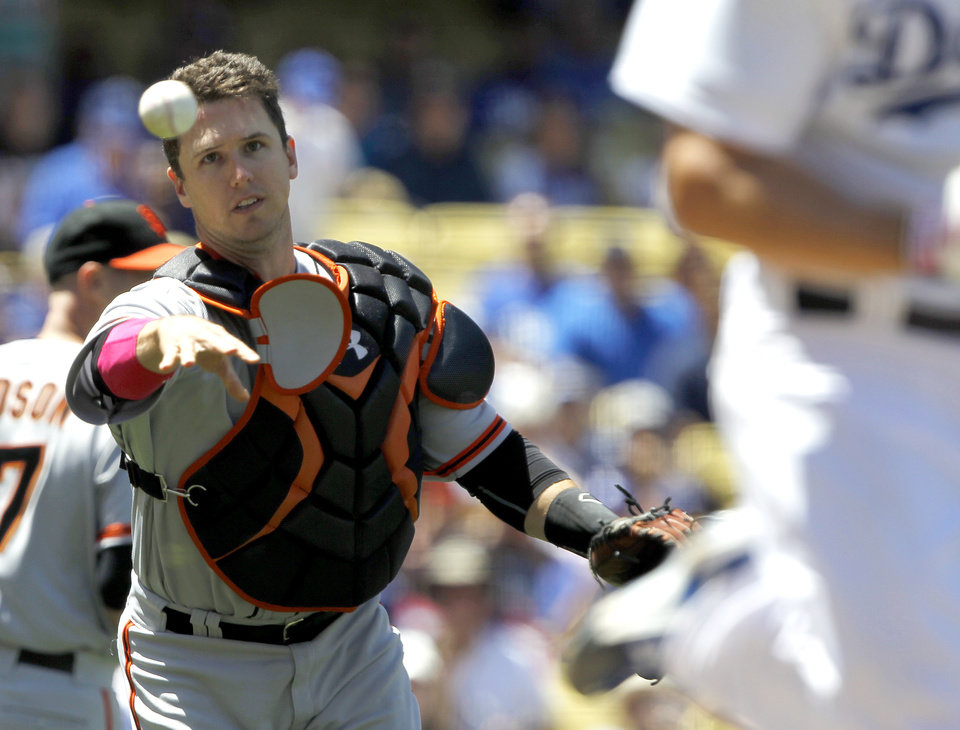 Photo - San Francisco Giants catcher Buster Posey throws out Los Angeles Dodgers' Clayton Kershaw on a sacrifice bunt in the third inning of a baseball game on Sunday, May 11, 2014, in Los Angeles. (AP Photo/Alex Gallardo)