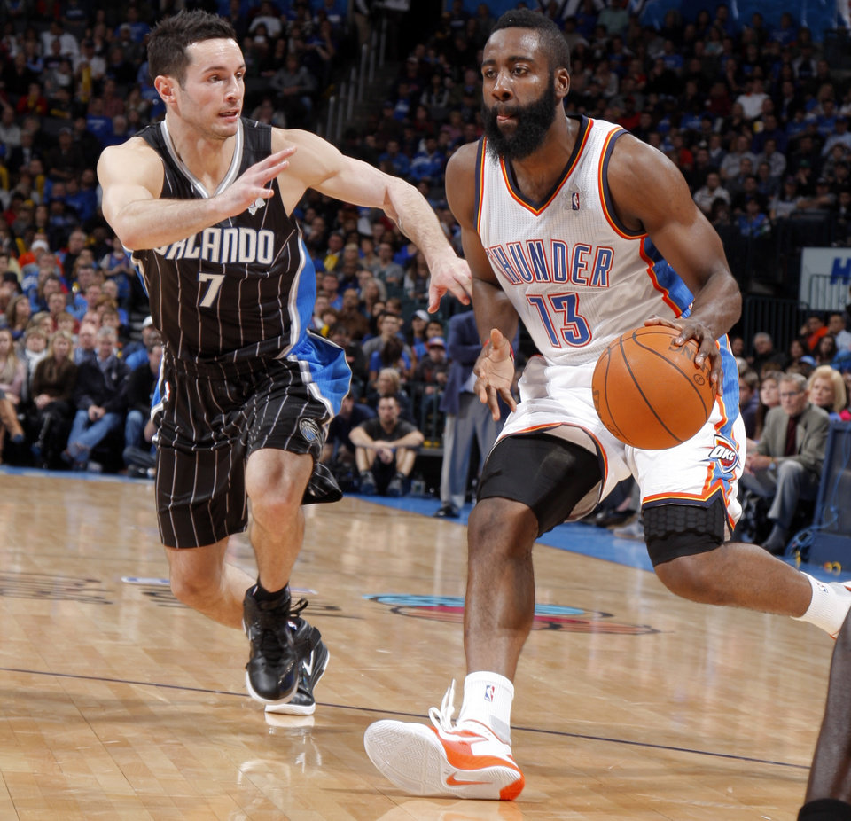 James Harden (13) gets by Orlando Magic's J.J. Redick (7) during the opening day NBA basketball game between the Oklahoma CIty Thunder and the Orlando Magic at Chesapeake Energy Arena in Oklahoma City, Sunday, Dec. 25, 2011. Photo by Sarah Phipps, The Oklahoman