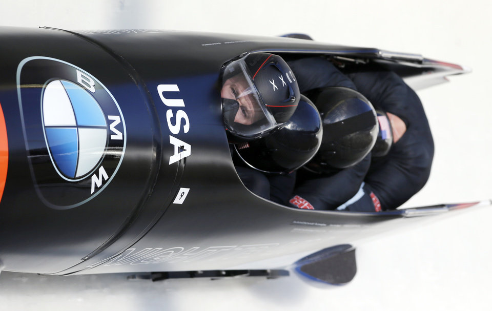 USA 1 pilot Steven Holcomb with pushers Justin Olsen and Steven Langton and brakeman Curtis Tomasevicz race to a second-place finish in the men's bobsled World Cup competition on Saturday, Nov. 10, 2012, in Lake Placid, N.Y. (AP Photo/Mike Groll)