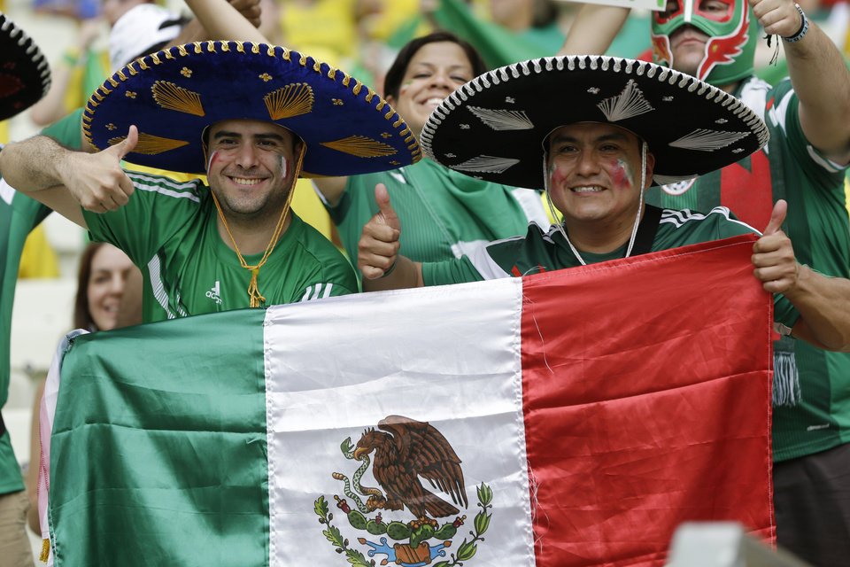 Photo - Mexico fans give thumb-up prior to the group A World Cup soccer match between Brazil and Mexico at the Arena Castelao in Fortaleza, Brazil, Tuesday, June 17, 2014. (AP Photo/Andre Penner)