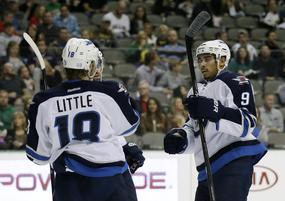 Photo - Winnipeg Jets' Bryan Little (18) congratulates Evander Kane (9) on his goal against the Dallas Stars in the second period of an NHL hockey game, Saturday, Oct. 26, 2013, in Dallas. (AP Photo/Tony Gutierrez)