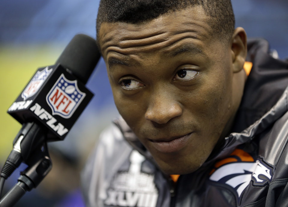 Photo - Denver Broncos' Demaryius Thomas listens to a question during media day for the NFL Super Bowl XLVIII football game Tuesday, Jan. 28, 2014, in Newark, N.J. (AP Photo/Mark Humphrey)