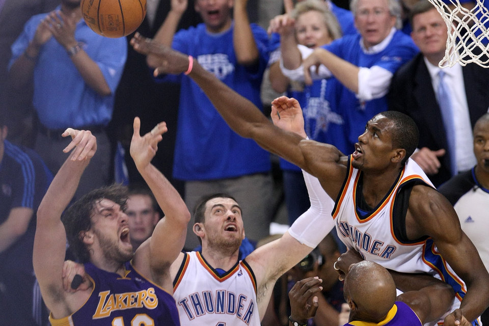 Photo - GAME THREE / FIRST ROUND / NBA PLAYOFFS / L.A. LAKERS / OKLAHOMA CITY THUNDER /LOS ANGELES LAKERS / NBA BASKETBALL  Oklahoma City Thunder forward Serge Ibaka goes for a block of L.A.'s Pau Gasol's shot as Nick Collison battles during the Thunder - Lakers game April 22, 2010 in the Ford Center in Oklahoma City.    BY HUGH SCOTT, THE OKLAHOMAN ORG XMIT: KOD